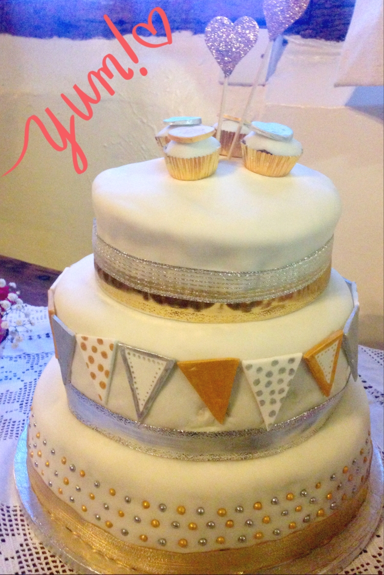 Homemade wedding cake made by the mother and sister of the bride. Top layer is victoria sponge, middle layer is carrot cake with lime icing and bottom layer is fruitcake.