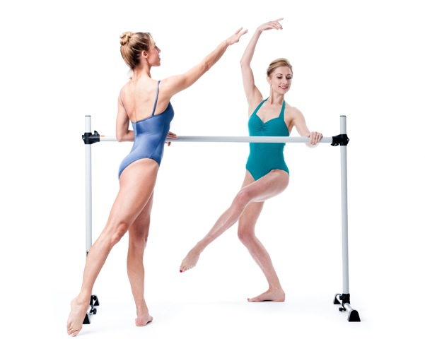 Victoria (r) and Flik (l) at the barre. You can substitute a chair for the barre when doing the at-home workouts.