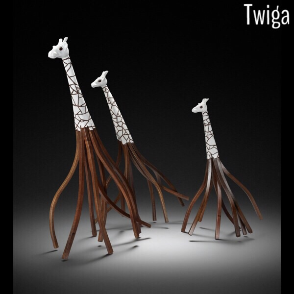 This set of Twiga (Swahili for giraffe) are made from Walnut and painted with gesso. Each is made from one solid piece of wood that has been altered on the cellular level. The legs are bent by hand into a form that captures the movement of a giraffe.